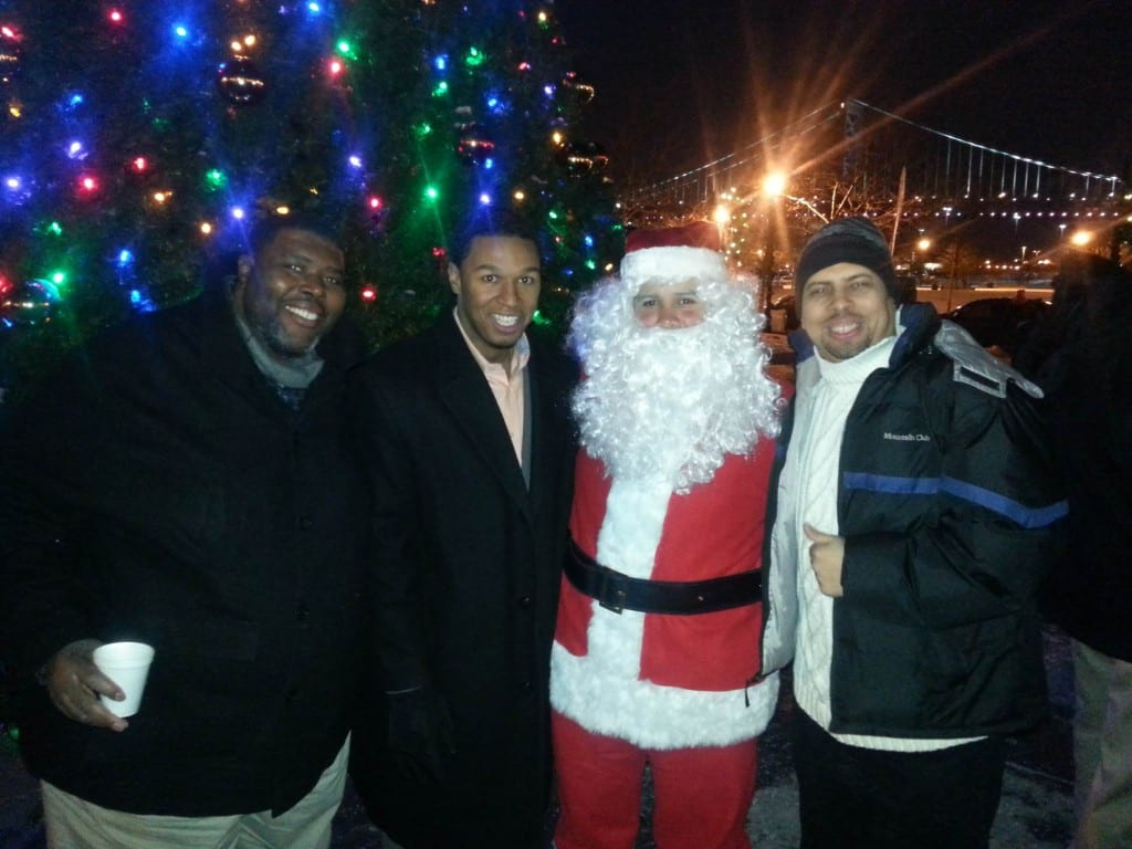 Christmas Tree Lighting Event with the Honorable Mayor Dana Redd Pictured Left to Right: Willie Hunter, Director of Operations; Falio Leyba Martinez, Commissioner; Santa Claus; Angel L. Alamo, Board Chairman.